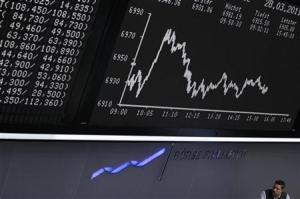 Trader is pictured in front of the DAX board at the Frankfurt stock exchange